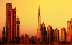 Dubai downtown on sunset. Picture of dubai downtown on sunset, arabian architecture, modern landmark,luxury building, burj khalifa in evening, beautiful Royalty Free Stock Photos