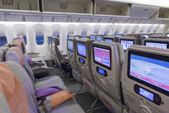DUBAI, EMIRATES - MARCH 14, 2016:  Boeing 777 EMIRATES Economy class with TV Touch screen in Emirates Airlines in Dubai Airport Stock Images