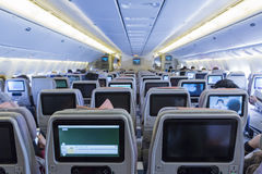 DUBAI, EMIRATES - MARCH 14, 2016:  Boeing 777 EMIRATES Economy class with TV Touch screen in Emirates Airlines in Dubai Airport Royalty Free Stock Photo