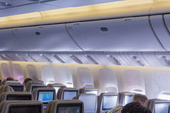 DUBAI, EMIRATES - MARCH 14, 2016:  Boeing 777 EMIRATES Economy class with TV Touch screen in Emirates Airlines in Dubai Airport Royalty Free Stock Images