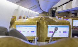 DUBAI, EMIRATES - MARCH 14, 2016:  Boeing 777 EMIRATES  First class with TV Touch screen in Emirates Airlines in Dubai Airport Royalty Free Stock Image