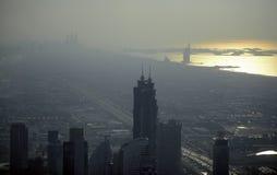 Dubai in evening haze, aerial view Stock Photos