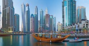 Dubai - The evening Marina. Skyscrapers and promenade royalty free stock photo