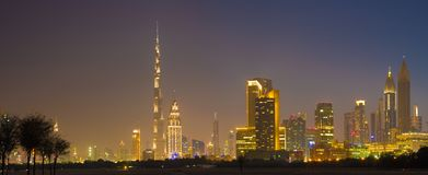 Dubai - The evening skyline of Downtown with the Burj Khalifa and Emirates Towers Stock Photo