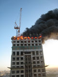 Dubai fire 2. Fire broke out in a 30-storey tower under construction on Shaikh Zayed Road. March 20, 2007 royalty free stock photo