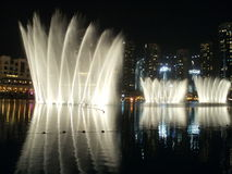 Dubai fountain performance. The Dubai Fountain is the worlds largest choreographed fountain system set on the 30-acre manmade Burj Khalifa Lake, at the center of Royalty Free Stock Images