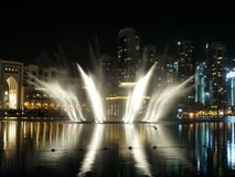 Dubai fountain performance. The Dubai Fountain is the worlds largest choreographed fountain system set on the 30-acre manmade Burj Khalifa Lake, at the center of Royalty Free Stock Image