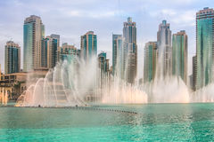 Dubai Fountain sunset show. The Dubai Fountain, the world largest choreographed fountain on Burj Khalifa Lake, performs at sunset, to the beat of the selected Royalty Free Stock Photography