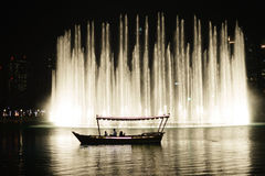 The Dubai Fountain. DUBAI, UAE - OCTOBER 15, 2014: The Dubai Fountain at night. The Dubai Fountain is the world's largest choreographed fountain system set on royalty free stock photo