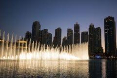 Dubai fountains, UAE. The Dubai Fountain performs daily, with the performance repertoire including Sama Dubai; Baba Yetu, an award-winning song in Swahili; the Stock Photography