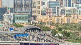 Dubai Golf Course with a cityscape of Gereens and tecom districts at the background aerial timelapse. Traffic on sheikh zayed road with junction and metro stock video