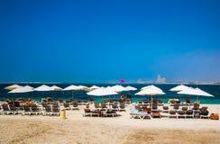 Dubai. Heavenly oasis in Ras al Khaimah. The beach with sunbeds and sunshades in Dubai, on the shores of the Arabian Gulf. Toning. Stock Photo