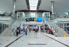 Dubai International Airport. Travellers in departure lounge of Dubai International Airport on June 20, 2014 in Dubai, UAE. This airport is the biggest in Middle stock photo