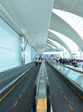 Dubai International Airport. Travellers in departure lounge of Dubai International Airport on June 20, 2014 in Dubai, UAE. This airport is the biggest in Middle stock images