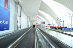 Dubai International Airport. Travellers in departure lounge of Dubai International Airport on June 20, 2014 in Dubai, UAE. This airport is the biggest in Middle stock image