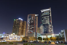 Dubai Internet City at night Stock Photos