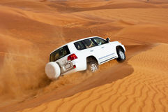 DUBAI - JUNE 2: Driving on jeeps on the desert, traditional entertainment Royalty Free Stock Photos