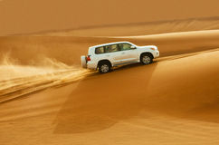 DUBAI - JUNE 2: Driving on jeeps on the desert Stock Images