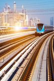 Dubai Lines Metro train. Dubai Metro Network line with sun subway monorail train automated royalty free stock photos