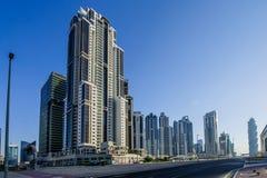 DUBAI - MAJ 11: Ner stad - grupp av byggnader i den Dubai ner staden, del av affärskorsningen projekt 11 Maj 2017, Dubai, UAE Royaltyfri Foto