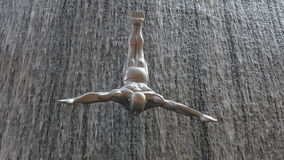 Dubai mall close up of waterfall diver sculpture 4k uae. Uae dubai mall close up of waterfall diver sculpture 4k stock footage