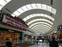 Dubai Mall interior design and Welcome signboard displaying the food court, Cinema and ice rink stock photography