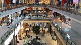 Dubai Mall modern interior design, the biggest mall in the world - Tourist attractions and landmarks in Dubai, UAE - people shoppi. Ng stock video