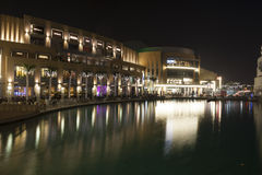 Dubai Mall at Night. Dubai Mall external area at night with lights reflecting nicely over the man made lake. The largest shopping mall in Dubai Royalty Free Stock Photography