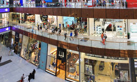 Dubai Mall, a top view of the inside, boutiques and shops, peopl. E walking and shopping, United Arab Emirates April 14, 2014, very soft focus, out of focus Stock Photography