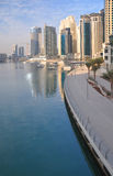 Dubai - Marina 1. The sun rises on the superb Dubai Marina surrounded by luxury high rise apartments royalty free stock images