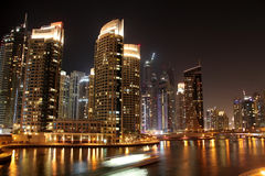 Dubai marina. Scenic view of illuminated of Dubai city at night with boats, United Arab Emirates Royalty Free Stock Image