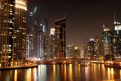 Dubai marina. Scenic view of illuminated of Dubai city at night with boats, United Arab Emirates Royalty Free Stock Photography