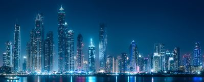 Dubai Marina bay view from Palm Jumeirah, UAE. Modern buildings of Dubai Marina bay with lights at night on background, view from Palm Jumeirah, UAE royalty free stock images