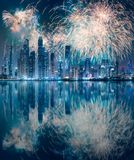 Dubai Marina bay view from Palm Jumeirah, UAE. Modern buildings on Dubai Marina bay at night with fireworks and reflection on water, UAE royalty free stock photo