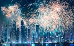 Dubai Marina bay view from Palm Jumeirah, UAE. Modern buildings on Dubai Marina bay at night with fireworks, UAE stock photos