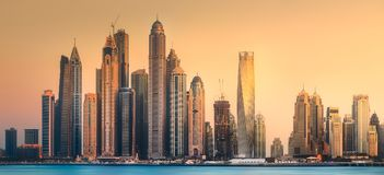 Dubai Marina bay view from Palm Jumeirah, UAE. Modern buildings with gold reflection of sunset on Dubai Marina bay view from Palm Jumeirah, UAE Royalty Free Stock Photography