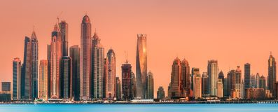Dubai Marina bay view from Palm Jumeirah, UAE. Modern buildings with gold reflection of sunset on Dubai Marina bay view from Palm Jumeirah, UAE royalty free stock photos