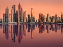 Dubai Marina bay view from Palm Jumeirah, UAE. Modern buildings with gold reflection of sunset on Dubai Marina bay view from Palm Jumeirah, UAE royalty free stock image