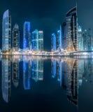 Dubai Marina bay view from Palm Jumeirah, UAE. Modern buildings of Dubai Marina bay with lights at night on background, view from Palm Jumeirah, UAE Stock Photography