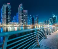 Dubai Marina bay view from Palm Jumeirah, UAE. Modern buildings of Dubai Marina bay with lights at night on background, view from Palm Jumeirah, UAE royalty free stock photo