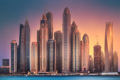 Dubai Marina bay view from Palm Jumeirah, UAE. Modern buildings of Dubai Marina bay view from Palm Jumeirah during sunset, UAE. Clipping path of sky stock photography