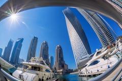 Dubai Marina with boats against skyscrapers in Dubai, United Arab Emirates Royalty Free Stock Photography
