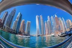 Dubai Marina with boats against skyscrapers in Dubai, United Arab Emirates Stock Images