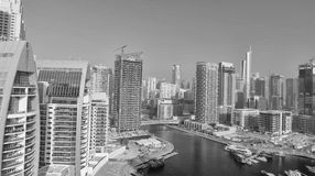Dubai Marina buildings along artificial canal, aerial view - UAE Stock Images