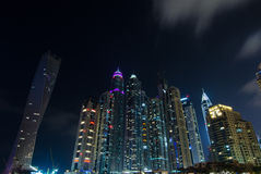 Dubai marina city lights lit up at night with famous landmarK Stock Images