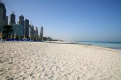 Dubai Marina complex under construction by beach. Dubai Marina complex while still under construction by beach Stock Image