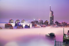 Dubai Marina is covered by early morning fog in Dubai, United Arab Emirates Stock Images