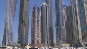 Dubai marina day time yacht dock buildings panorama 4k uae stock video footage