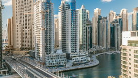 Dubai Marina at evening timelapse with trails of boats on the water and cars traffic, Dubai, UAE stock video
