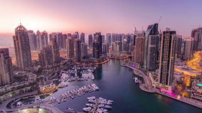 Dubai marina harbor panorama from night to day
